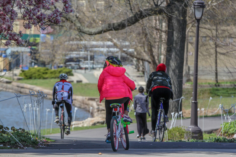 Bicyclists, joggers and walkers enjoy a beautiful day during the coronavirus shutdown on the Schuylkill River Trail near Boathouse Row in Philadelphia, Pa. (Emma Lee/WHYY)