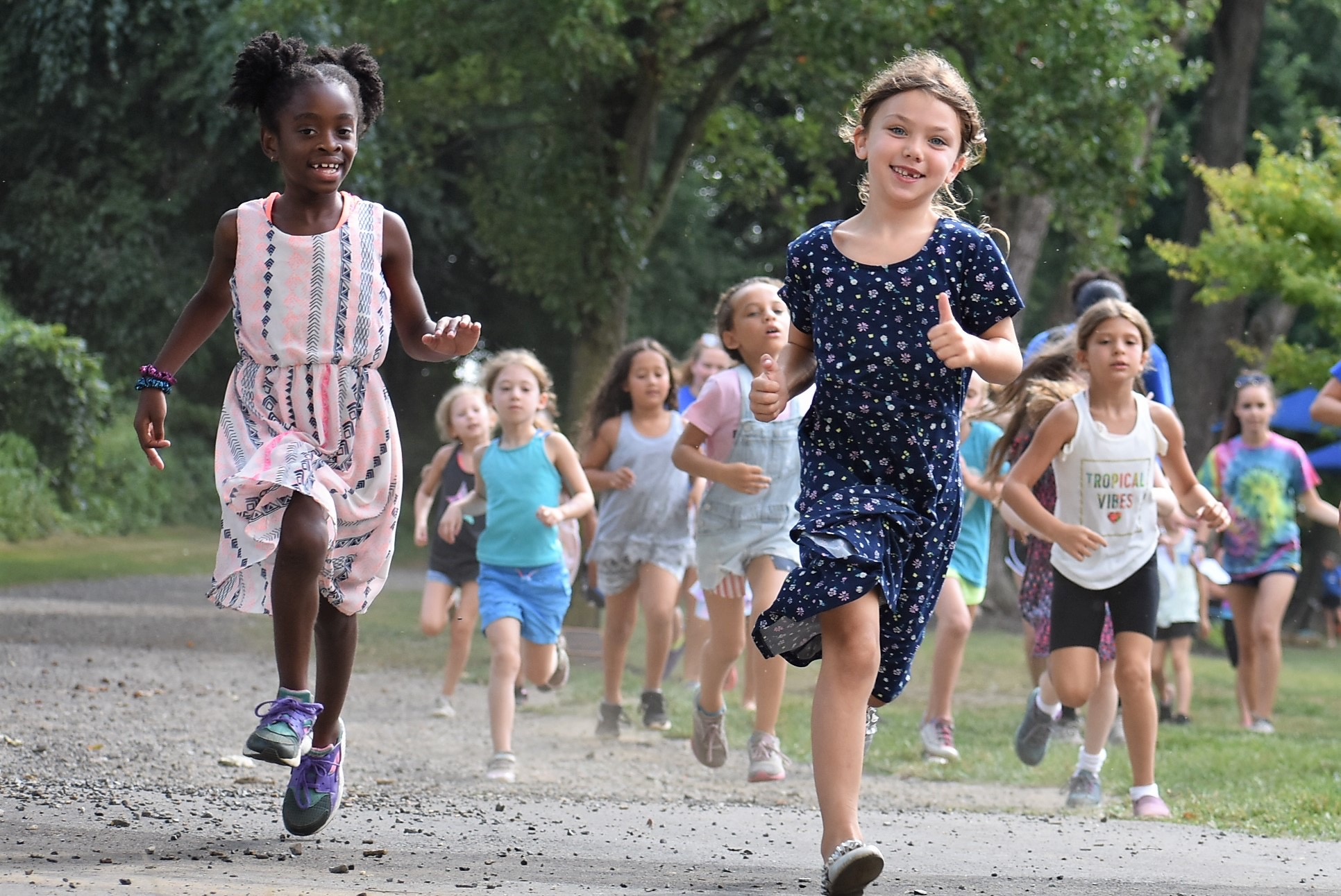 Campers run at Liberty Lake Day Camp in Mansfield Township, N.J.