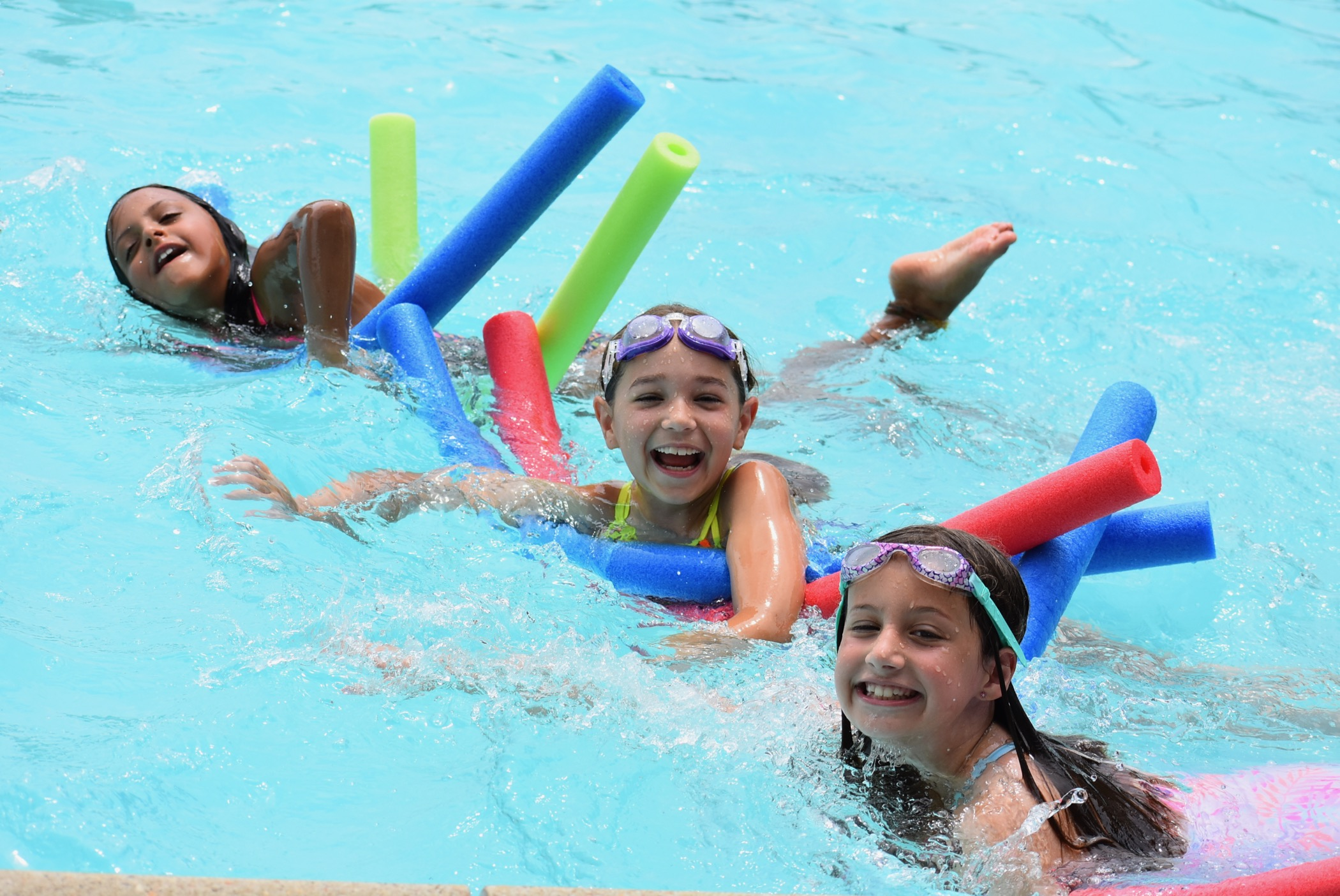 Campers swim at Liberty Lake Day Camp in Mansfield Township, N.J.