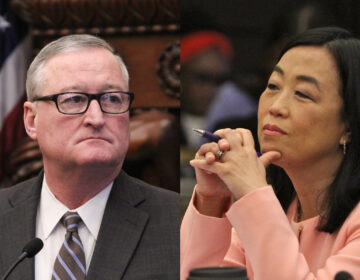 City Councilmember Helen Gym and Mayor Jim Kenney. Gym has challenged proposed cuts to city housing programs. (Emma Lee/WHYY)