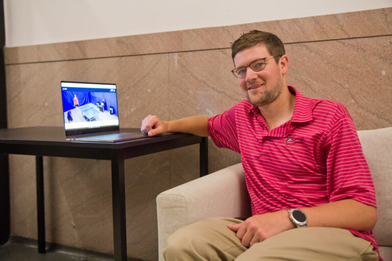 Matthew Nelson watches Russian table tennis in the lobby of his apartment building after placing a bet. (Kimberly Paynter/WHYY)