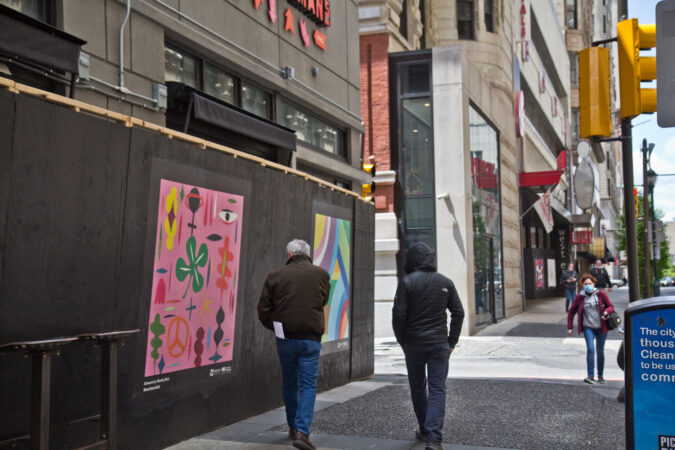 The Mural Arts Program installed works on storefronts boarded up due to coronavirus lockdowns in Center City. This work on Chestnut Street is by artist Martha Rich. (Kimberly Paynter/WHYY)