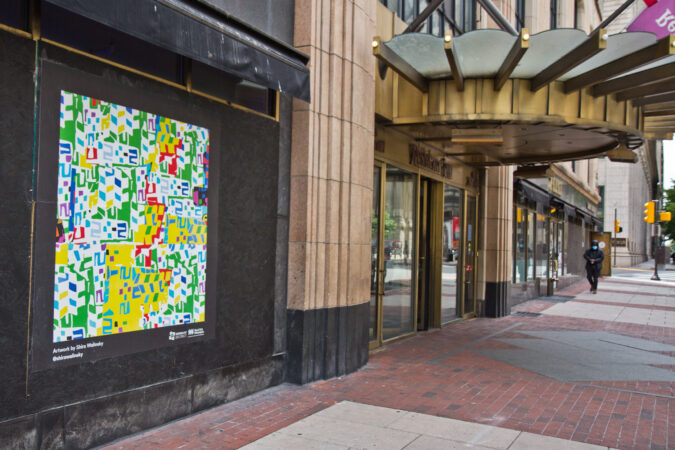 The Mural Arts Program installed works on storefronts boarded up due to coronavirus lockdowns in Center City. This abstract piece across from City Hall is by artist Shira Walinsky. (Kimberly Paynter/WHYY)