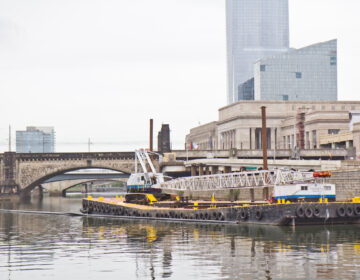 An Atlantic Subsea, Inc. crane barge on the Schuylkill along the river trail