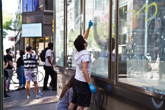 People worked to clean the graffiti everywhere in Center City Philadelphia. (Kimberly Paynter/WHYY)