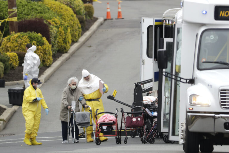 Residents from St. Joseph's Senior Home are helped on to buses in Woodbridge
