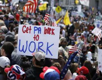 Protesters demonstrate at the state Capitol in Harrisburg, Pa., Monday, April 20, 2020, demanding that Gov. Tom Wolf reopen Pennsylvania's economy even as new social-distancing mandates took effect at stores and other commercial buildings. (AP Photo/Matt Slocum)