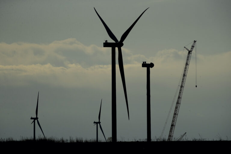 Wind turbines stand in various stages of completion at the Reading Wind Facility in Reading, Kan., on Thursday, April 23, 2020. (AP Photo/Charlie Riedel)