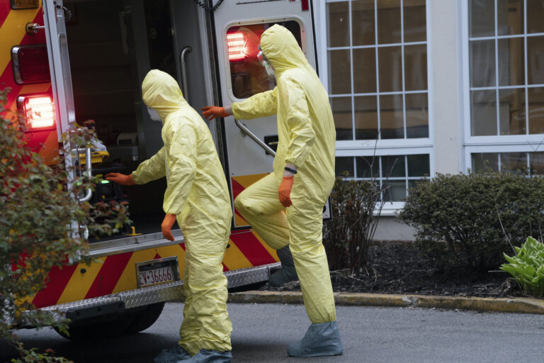 Narberth Ambulance Paramedic Andrew Schifferli, left, and EMT Eric McKeever, right, wear full PPE during a call at a nursing home in Wynnewood, PA, on April 17, 2020, in Ardmore, Pa. (Jessica Griffin/Philadelphia Inquirer)