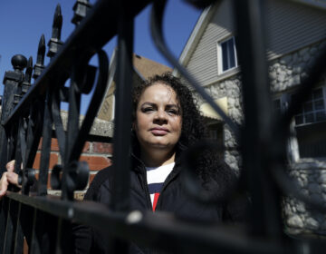 Nelis Rodriguez poses at her home in Chicago, Thursday, May 7, 2020. (AP Photo/Nam Y. Huh)
