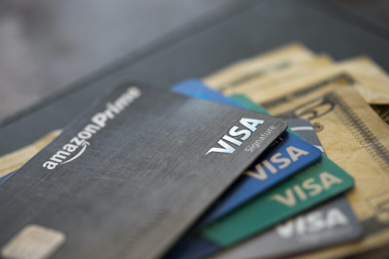 This Aug. 11, 2019 file photo shows credit cards in New Orleans. (AP Photo/Jenny Kane)