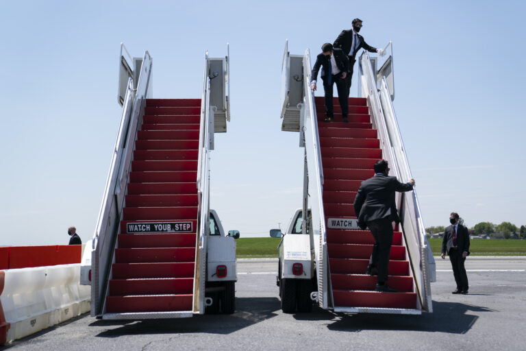 Members of the White House Military Office clean the stair for Air Force One ahead of the arrival of President Donald Trump for a tour of Owens & Minor Inc., a medical supply company, Thursday, May 14, 2020, in Allentown, Pa. (AP Photo/Evan Vucci)