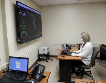 In this Wednesday, May 13, 2020 photo, Meghan Peck works on contact tracing at the Florida Dept. of Health in Miami-Dade County, during the new coronavirus pandemic, in Doral, Fla. (AP Photo/Lynne Sladky)