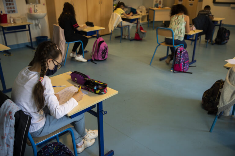 Students, wearing face masks and paying attention to social distancing, study at Les Magnolias primary school during the partial lifting of coronavirus, COVID-19, lockdown regulations in Brussels, Monday, May 18, 2020. (AP Photo/Francisco Seco)