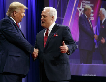 In this Feb. 29, 2020, file photo, President Donald Trump is greeted by Matt Schlapp, Chairman of the American Conservative Union, as the president arrives to speak at the Conservative Political Action Conference,  at National Harbor, in Oxon Hill, Md. (AP Photo/Jacquelyn Martin, File)