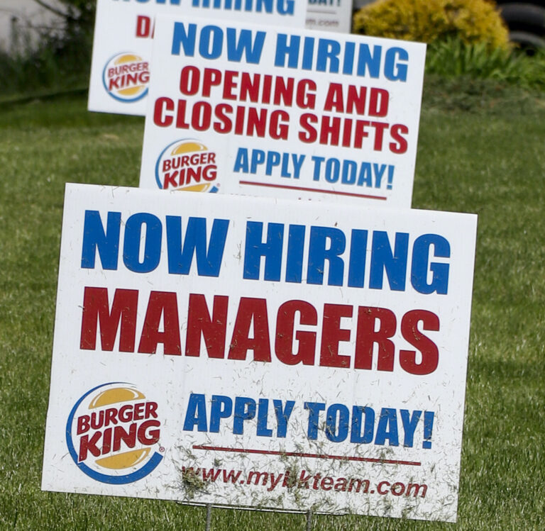 A row of signs advertising jobs are posted in front of a Burger King restaurant, Thursday, May 21, 2020, in Harmony, Pa. (AP Photo/Keith Srakocic)