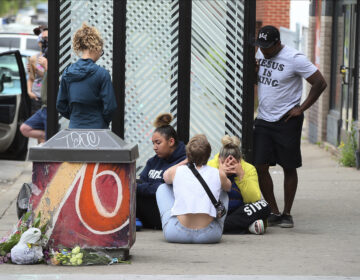Mourners gather around a makeshift memorial, Tuesday, May 26, 2020 in Minneapolis, near where an black man was taken into police custody the day before who later died. (AP Photo/Jim Mone)