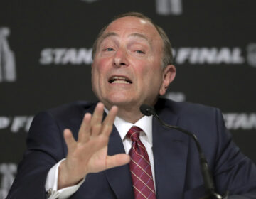 In this May 27, 2019, file photo, NHL Commissioner Gary Bettman speaks to the media before Game 1 of the NHL hockey Stanley Cup Finals between the St. Louis Blues and the Boston Bruins, in Boston. (AP Photo/Charles Krupa, File)