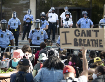 Protesters gather at the Philadelphia Police Department Headquarters during a rally