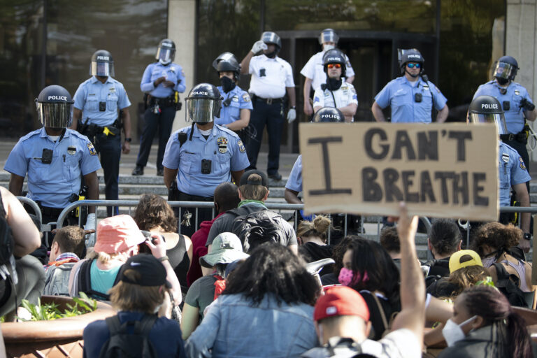Protesters gather at the Philadelphia Police Department Headquarters during rally Sunday May 31, 2020, in Philadelphia over the death of George Floyd. Floyd died May 25 after he was pinned at the neck by a Minneapolis police officer. (Jose F. Moreno/The Philadelphia Inquirer via AP)