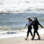 People wear protective face masks on NJ beach