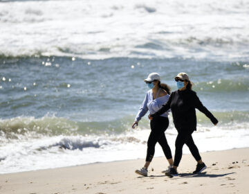 People wear protective face masks on NJ beach