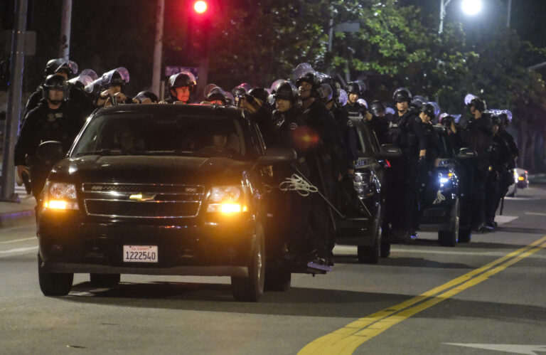 LAPD riot police stand by outside City Hall during a protest of the death of George Floyd
