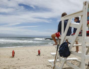 Lifeguards keep watch at a beach
