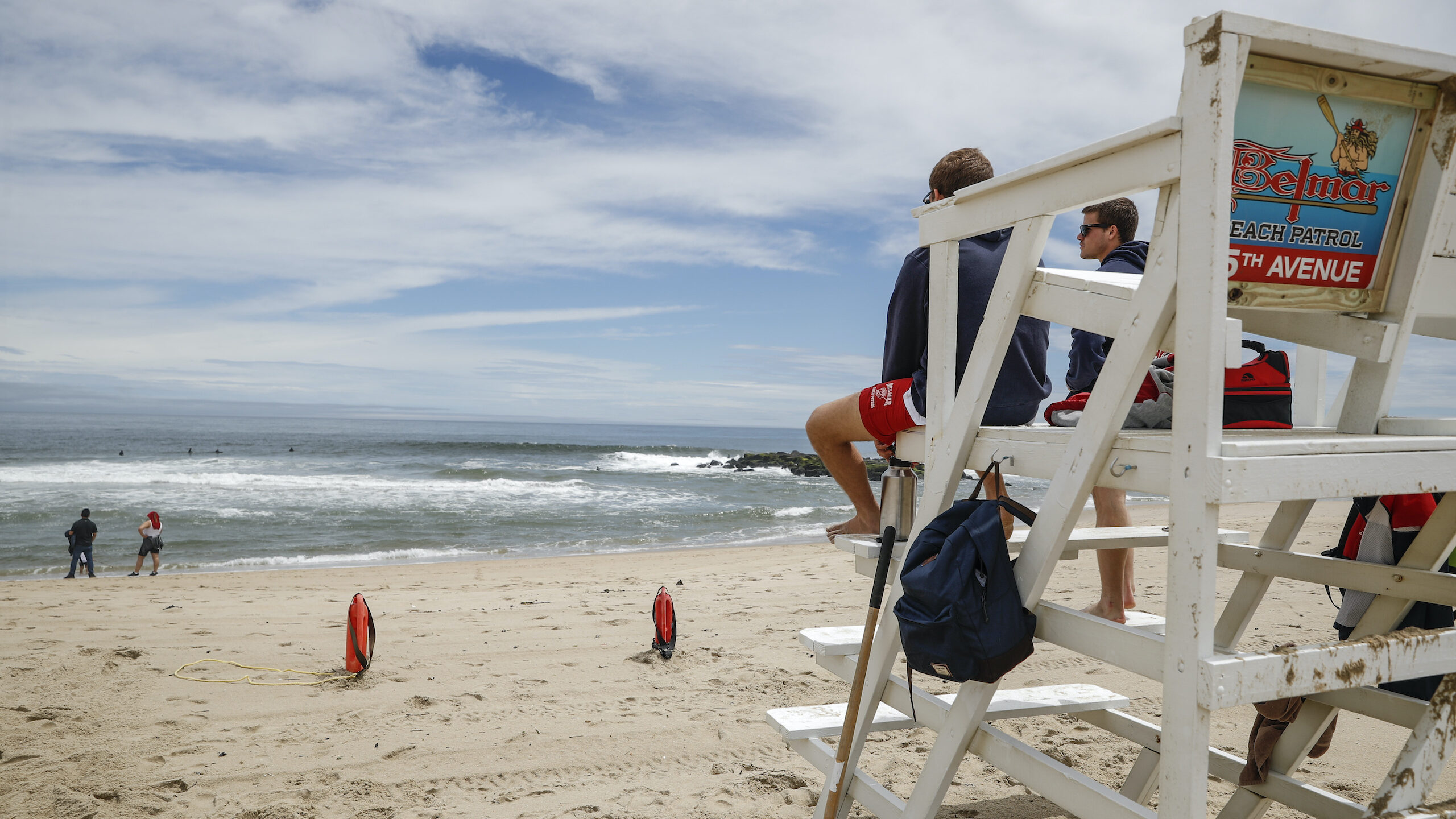 Lifeguards keep watch at a mostly empty N.J. beach