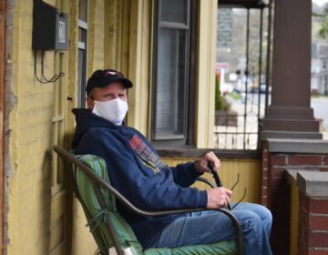 Scott Hoffman sits on his porch in Sunbury, Northumberland County, on April 29, 2020. (Ed Mahon / PA Post)