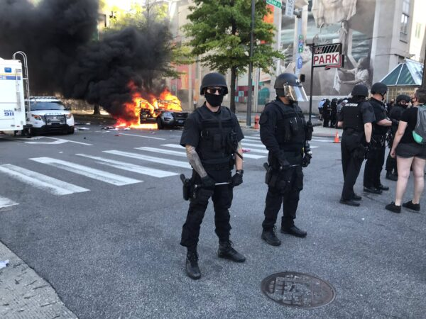 A state police car was set on fire during a march in Center City protesting police violence. (Alan Yu/WHYY)