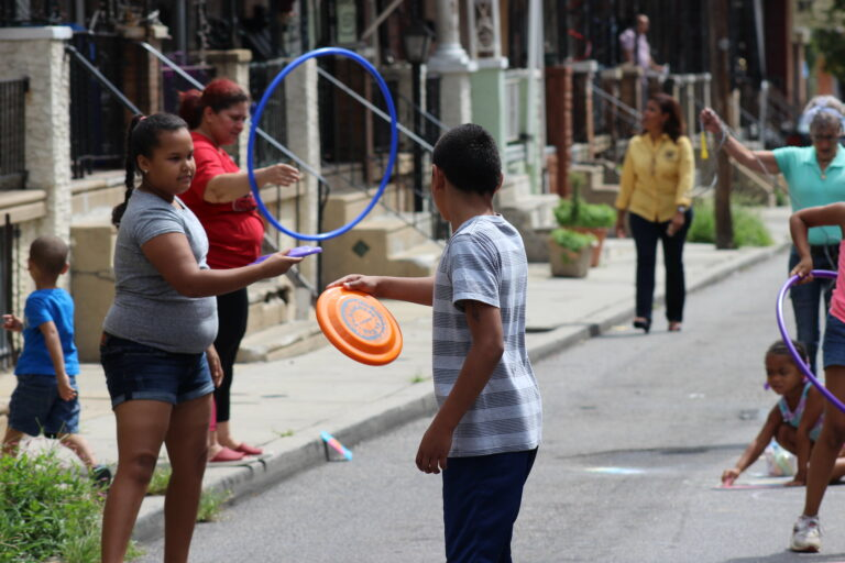 Families play on a North Philadelphia Playstreet in a 2018 photo. (Courtesy of the City of Philadelphia)