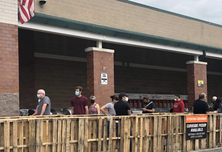 Customers lined up with masks and mostly maintained their distance Sunday at the Home Depot near Newark, Delaware. (Cris Barrish/WHYY)