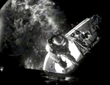 A screen capture from a U.S. Coast Guard video of the successful hoisting of two people from a grounded fishing vessel in the Barnegat Inlet Wednesday night. (U.S. Coast Guard)