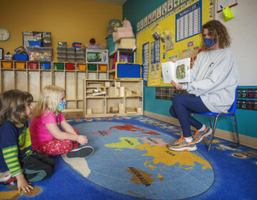 A teacher reads to kids at Step by Step School for Early Learning in State College, Pa. (Min Xian/Keystone Crossroads)
