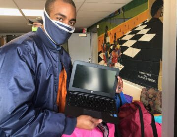 Markevis Gideon displays one of the devices his company gave to Kingswood preschoolers. (Cris Barrish/WHYY)
