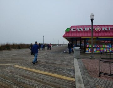 Few people were walking along the Rehoboth Beach boardwalk just hours before the state's beaches reopened Friday at 5 p.m. (Zoë Read/ WHYY)