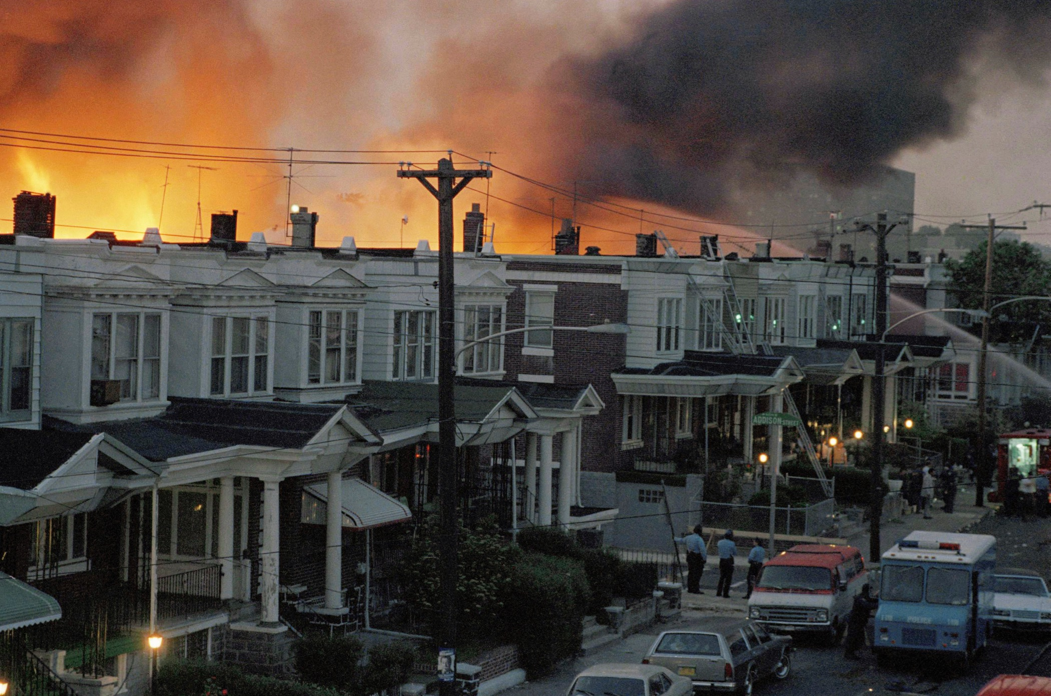 In this May, 1985 file photo, scores of rowhouses burn in a fire in the west Philadelphia neighborhood. Police dropped a bomb on the militant group MOVE's home on May 13, 1985 in an attempt to arrest members, leading to the burning of scores of homes in the neighborhood. (AP Photo, File)