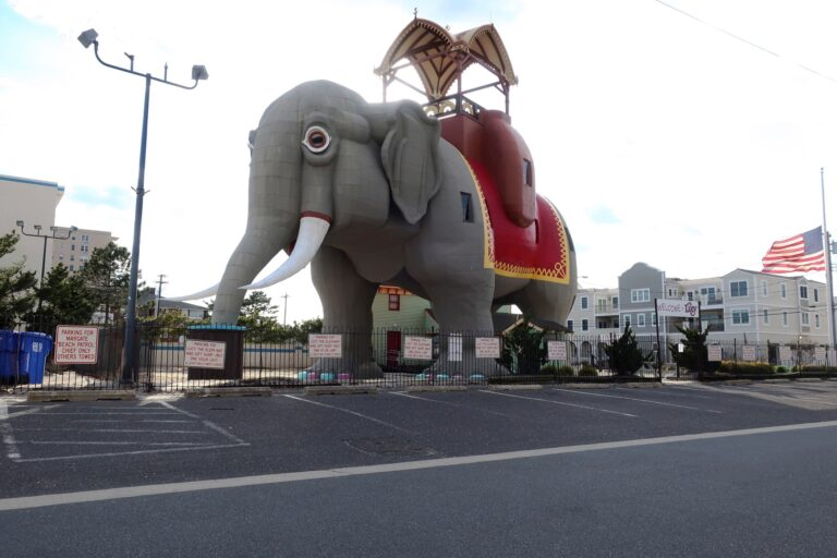 National Historic Landmark Lucy the Elephant is closed to visitors and the parking lot is empty in Margate, New Jersey, during the coronavirus pandemic while a flag flies at half staff on April 10, 2020. (AP Photo/Ted Shaffrey)