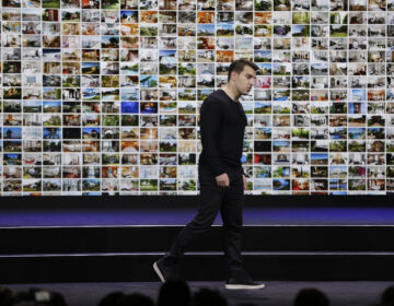 Airbnb co-founder and CEO Brian Chesky during an event in 2018. On Tuesday, the company announced it is laying off 1,900 employees, or about a quarter its workforce, as the coronavirus rattles the travel industry. (Eric Risberg/AP Photo)