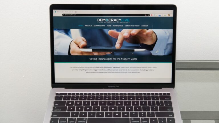 The Democracy Live home page is displayed on an Apple laptop computer. The company is administering a ballot return system for disabled voters in West Virginia, Delaware, and potentially New Jersey. (Courtesy of Democracy Live)