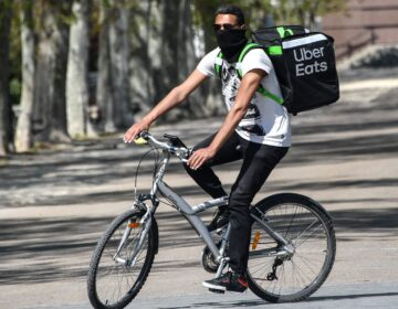 Uber is restructuring its business to focus on rides and food delivery, which has been a bright spot for the company during the pandemic. (Pascal Guyot/AFP via Getty Images)
