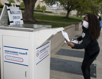An Ohio voter drops off her ballot at the Board of Elections in Dayton, Ohio on April 28, 2020. Legal fights around mail-in voting are heating up as states turn to it amid the coronavirus pandemic. (Megan Jelinger/AFP via Getty Images)