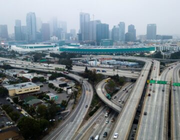 An aerial view shows downtown Los Angeles on April 30. U.S. miles driven decreased remarkably quickly in March, and driving slowly started to resume again — while remaining well below typical levels. (Robyn Beck/AFP via Getty Images)