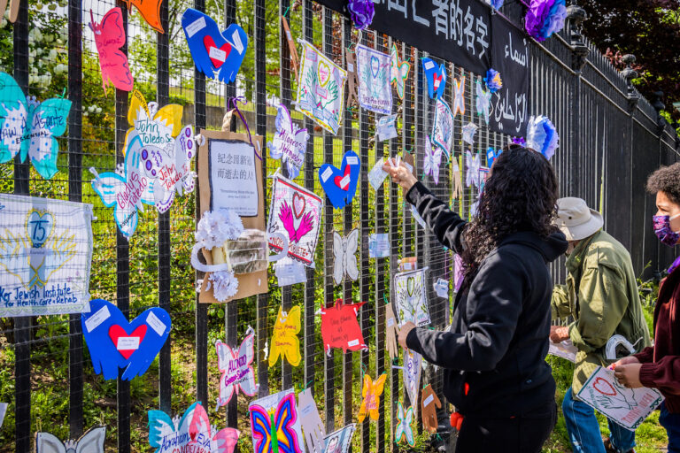 A volunteer artist sets up a memorial in Brooklyn on May 20. Artists and volunteer organizers across New York City put up physical memorials throughout the five boroughs in connection with Naming the Lost to honor the lives lost to COVID-19. (Erik McGregor/LightRocket via Getty Images)