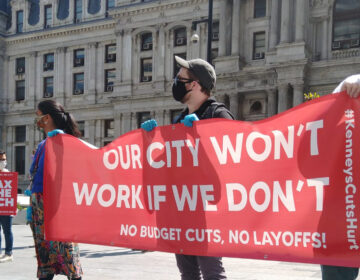 City employees staged a socially distant rally outside City Hall to protest planned layoffsTWITTER / @TERRAOLVR