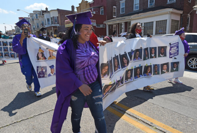 During the parade on June 26, Brimm graduate Iyana Lugo, 18, carried a banner.