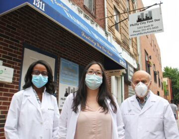 Philly City Foot Doc podiatrists (from left) Priscilla Howie, Kim Nguyen and Michael Walinsky outside their South Street offices. (Emma Lee/WHYY)