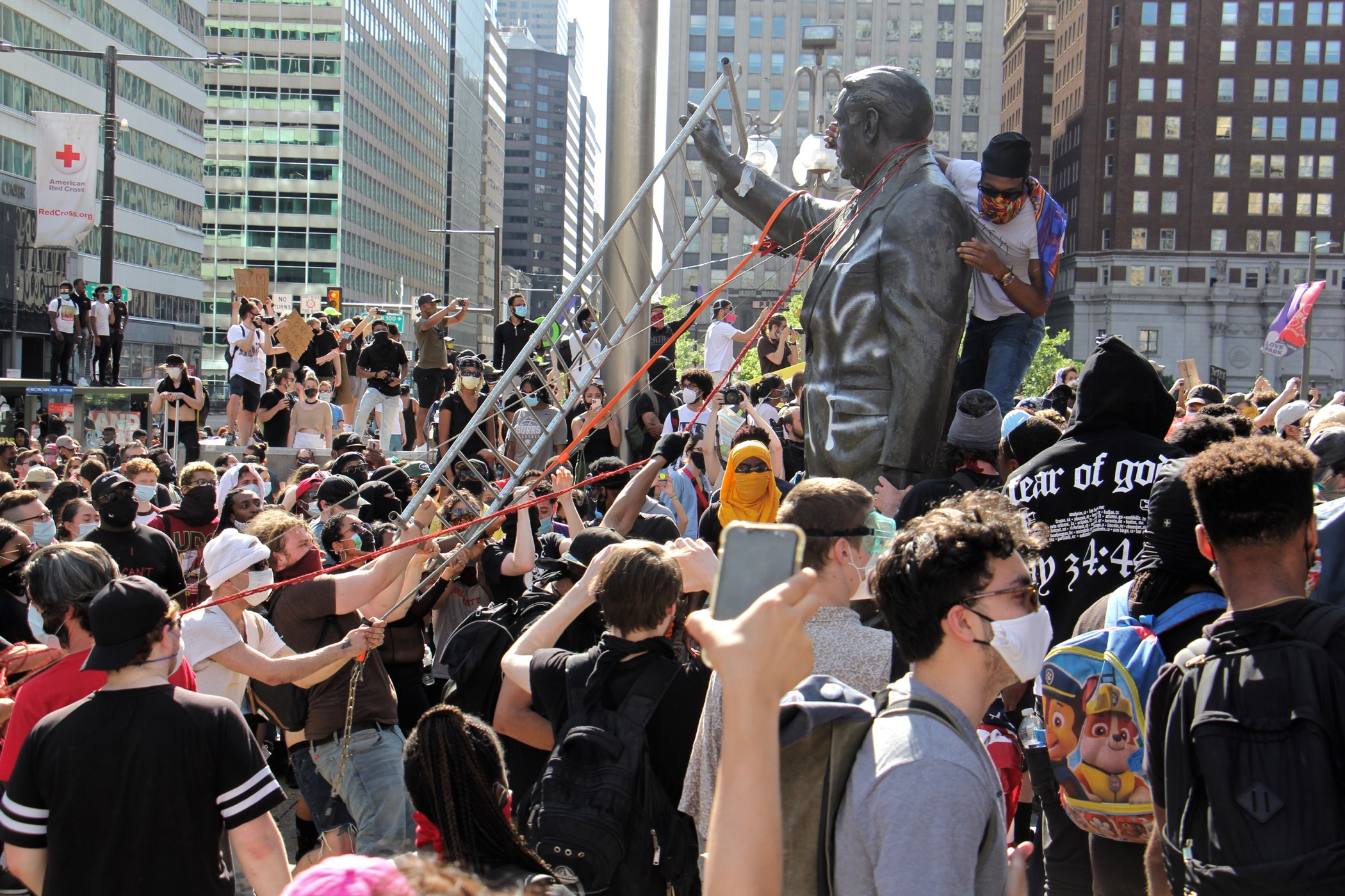 Protesters try to take down the statue of former mayor and police chief Frank Rizzo