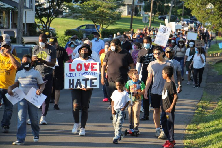 Hundreds march through the Linconia neighborhood of Bensalem Township to remember George Floyd and others who have died at the hands of the police. (Emma Lee/WHYY)